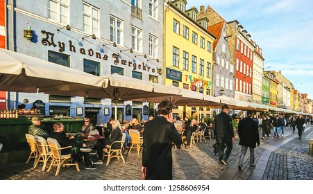 Copenhagen, Denmark - September 25, 2018: Scenic view of Nyhavn pier with colored buildings, ships, yachts and other boats in the Old Town.