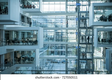 Copenhagen, Denmark - September 29, 2017: Information technology scientists working in surrealistic modern building of IT University.