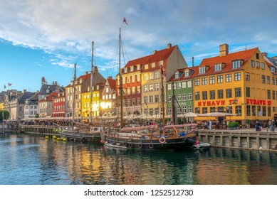 COPENHAGEN, DENMARK - SEPTEMBER 30, 2016: Cloud of tourists at Nyhavn. It is one of the most famous landmark in Copenhagen with colorful buildings.