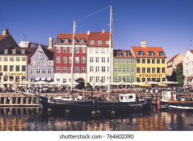 COPENHAGEN, DENMARK - SEPTEMBER 9: people in open cafes of the famous Nyhavn promenade on September 9, 2016 in Copenhagen, Denmark. Nyhavn is one of the most famous landmark of Copenhagen.