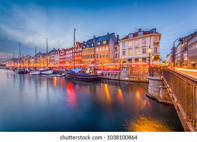 Copenhagen, Denmark skyline on the Nyhavn Canal at twilight.