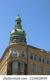 Copenhagen, Denmark - view of  an antique building tower in city center with the green copper decorated cover characteristic of the city profile