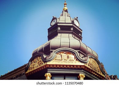 Copenhagen, Denmark - view of  an antique building dome in city center with the green copper decorated cover characteristic of the city profile