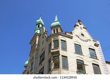 Copenhagen, Denmark - view of  the towers of an antique building  in city center  with the green copper decorated cover characteristic of the city profile