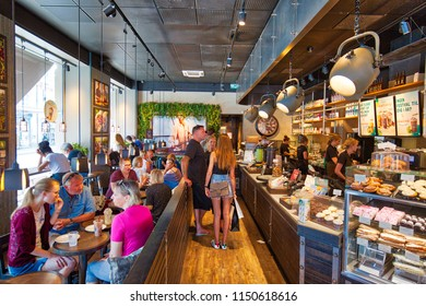 Copenhagen, Denmark-August 1, 2018: People eating in busy cafe located on Kongens Nytorv central city square