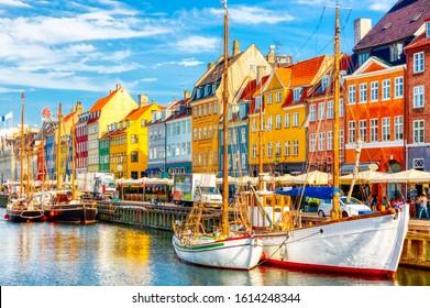 Copenhagen iconic view. Famous old Nyhavn port in the center of Copenhagen, Denmark during summer sunny day