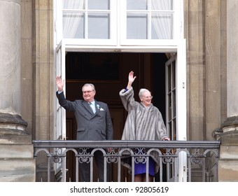 COPENHAGEN - JAN 15: HRH Queen Margrethe of Denmark and Prince Henrik wave to the crowd at Amalienborg Palace during the celebration of her 40th jubilee on January 15, 2012 in Copenhagen, Denmark.