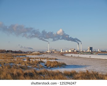 COPENHAGEN - JAN 20: The Amager Power Station viewed from the Amager Beach Park in Copenhagen, Denmark on January 20, 2013. It supplies 346.000 households with electricity.