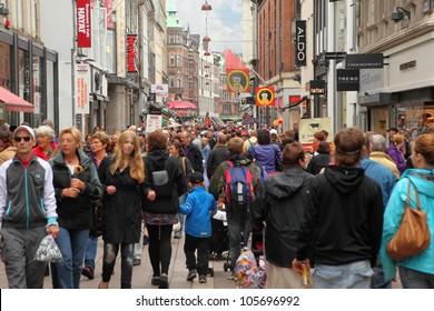 COPENHAGEN  - JULE 23: People walk down Stroget street on Jule 23, 2011 in Copenhagen, Denmark. Stroget - longest pedestrian street in world.