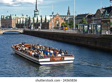 COPENHAGEN - JULY 12: Around 70 unknown tourists touring the Old Canal in Copenhagen, Denmark on July 12, 2008. A 60-minute guided tour costs  US$10 for adults & US$7 for children aged 3 -11.