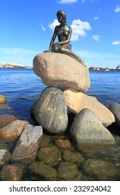 COPENHAGEN - JUNE 30: The Little Mermaid, a bronze statue by Edvard Eriksen, depicting a mermaid. The sculpture is displayed by the waterside at the Langelinie promenade in Copenhagen, Denmark