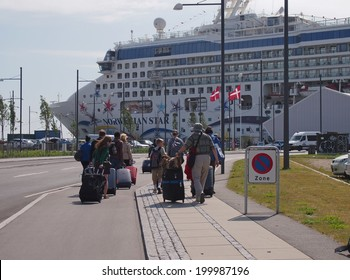 COPENHAGEN - JUNE 6: International cruise passengers on their way to the newly opened three-berth Ocean Quay in Copenhagen, Denmark on June 6, 2014. The quay is served by three terminals.