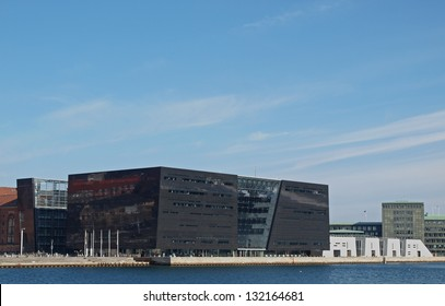 COPENHAGEN - MAR 16: The Royal Library of Copenhagen, Denmark (The Black Diamond) seen from a canal sight-seeing tour at the inner harbour of Copenhagen, Denmark on March 16, 2013.