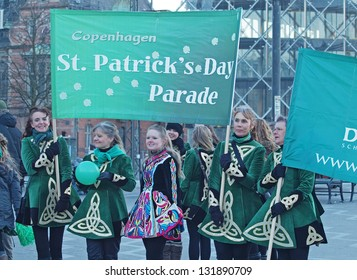 COPENHAGEN - MAR 17: Participants at the annual St. Patrick's Day celebration and parade in front of Copenhagen City Hall, Denmark on March 17, 2013.