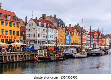 COPENHAGEN - MARCH, 2019: Famous for its colorful 17-18th century townhouses Nyhavn (New Harbour) under iron skies