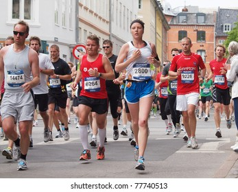 COPENHAGEN - MAY 21: More the 12,000 runners from 40 countries participate in the yearly Copenhagen Marathon. It covers a 42- kilometer route mostly within the city centre in Copenhagen, Denmark on May 21, 2011.