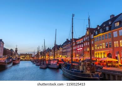 Copenhagen night city skyline at Nyhavn harbour, Copenhagen Denmark