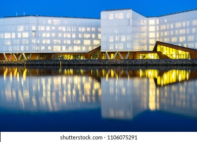 Copenhagen, Nordhavnen / Denmark - 06 02 2018: The UN City in Copenhagen and its reflection at night. Several human rights and world health organizations are located here in this building.