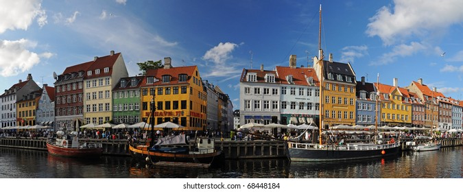 Copenhagen (Nyhavh) in a sunny summer day, panorama of old historical harbor, Denmark