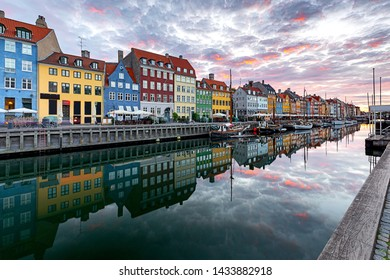 Copenhagen. Nyhavn Canal, colorful houses and city embankment at sunrise.