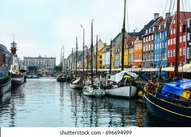 Copenhagen Nyhavn (New Harbour), in Copenhagen, Denmark. New port of Copenhagen. Colorful old town architecture. Copenhagen style, European street