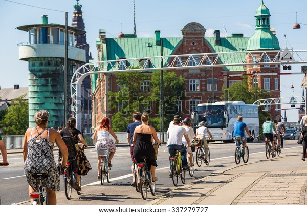 Copenhagen is one of the most bicycle friendly cities in the World.  Copenhagen, Denmark in a summer day