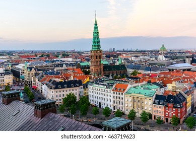 Copenhagen skyline by evening. Denmark capital city streets and danish house roofs. Copenhagen old town and copper spiel of Nikolaj Church panoramic view from top of Christiansborg palace.