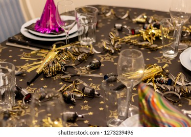 Copenhagen, Soeborg / Denmark - 12/31/2018: Table set for new years party with glasses confetti and other novelty items