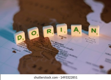 Copenhagen, Zealand / Denmark - September 1 2019: A hurricane Dorian approaching North America. Dorian on the map of North America made out of scrabble letters