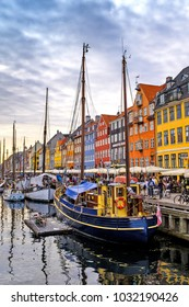 Copenhagen, Zealand region / Denmark - 2017/07/26: city center - panoramic view of the Nyhavn district with boats and tenement houses along the Nyhavn canal