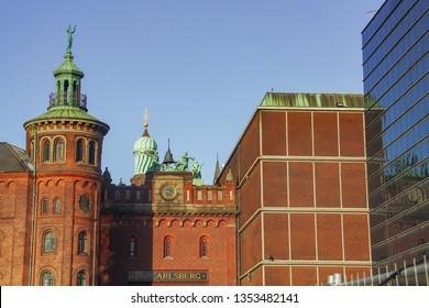 Copenhagen/Denmark; 02/16/2016.Carlberg district. Carlbersg breweries. The old factory of Carlsberg beer in Copenhagen. The clock of the elephant tower.