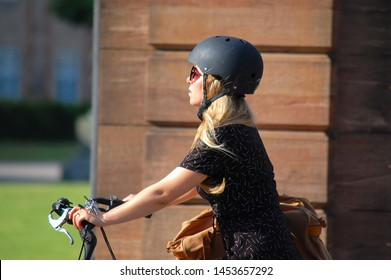 Copenhagen/Denmark - 17 June 2019: cyclist in the city. Woman riding bicycle on the street.