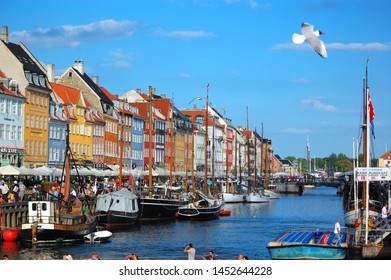 Copenhagen/Denmark - 17 June 2019: Nyhavn is a 17th-century waterfront, canal and entertainment district in Copenhagen, Denmark.