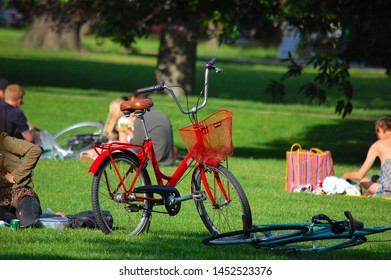 Copenhagen/Denmark - 17 June 2019: People enjoying relaxing outdoors in city park in Copenhagen. Bicycle on green grass in the park.