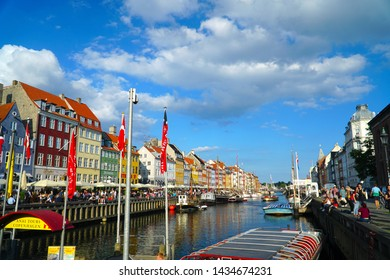 Copenhagen/Denmark - 17 June 2019: Scenic summer view of Nyhavn pier with color buildings, ships, yachts and other boats in the Old Town of Copenhagen, Denmark.
