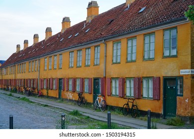 Copenhagen/Denmark - 18 June 2019: Bicycles along the old building wall. Copenhagen, Denmark.