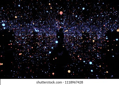 """Copenhagen/Denmark - October  13,2017 : An installation art """"Gleaming Lights of the Souls"""" by Japanese artist ,Yayoi Kusama.Infinity Mirrored Room - Filled with the Brilliance of Life."""