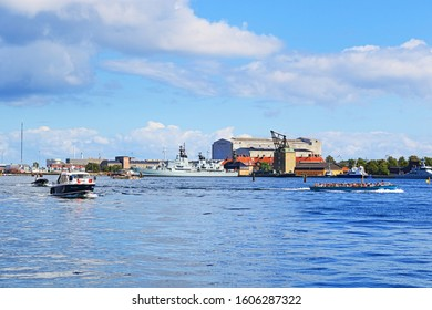 Copenhagen,Denmark-August 9th 2019:View of  the harbour,tourist boats navigating and Holmen naval base with the Peder Skram frigate history museum -a class of frigate built for the Royal Danish Navy