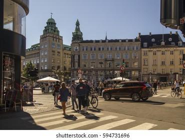 COPENHAGEN,DENMARK-SEPTEMBER 5:Pedestrians in central Copenhagen Gammeltorv and Caritas Fountain-oldest in Copenhagen on September 5,2016 The part of Stroget pedestrian zone