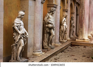Copies of classic Greek statues adorn facade of an abandoned hotel. Plaster copies of Greek and Roman antique sculptures of mythology of ancient Greece as an ornament of facade of building