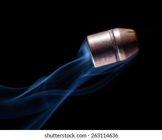 Copper bullets that has smoke coming from behind