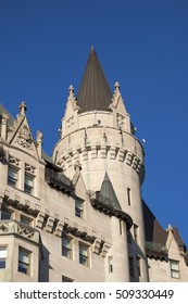 A copper clad turret and building of the Chateau Laurier in capital city of Ottawa Ontario Canada. The building was built in the French Gothic Chateau Style.