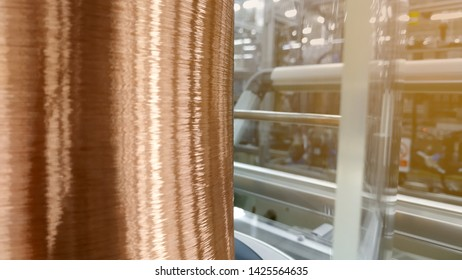 Copper coil is used for winding up to create an electromagnetic field, blur background.