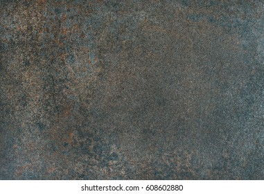 Copper colored natural stone texture, wallpaper and background. Stone formation with iron ore. Natural dark texture, surface and wallpaper. Rustic style stone background