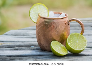 Copper cup  with lime and ice.