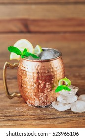 Copper cup with lime and ice. Moscow mule
