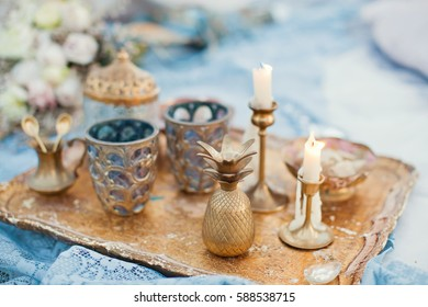 copper decor with candles, lamp and glass