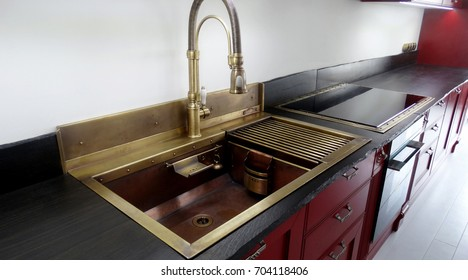 Copper double sink in the kitchen interior