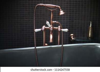 Copper faucet mixer with porcelain handles, stylized antique, shower in the bathroom