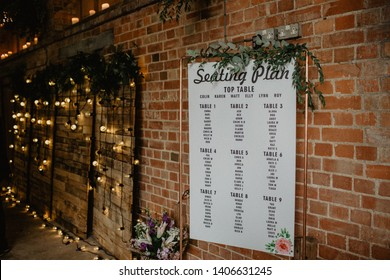 Copper frame, hung seating plan for wedding reception